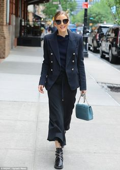 Nautical-inspired: Olivia Palermo sported a navy-blue monochromatic ensemble while strolli...