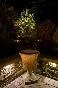 Allen roth 4 light bronze low voltage led path lights landscape strategically placed led lights under the cap stone of the wall are both functional and decorative aloadofball Choice Image