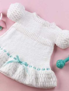 Knitting - Baby Knitting PatternsDress up a baby girl in this easy to knit party dress. Knitted with sport weight yarn and size 6 circular knitting needle. Free Baby Sweater Knitting Patterns, Free Baby Patterns, Knitting For Kids, Crochet For Kids, Knit Patterns, Free Knitting, Crochet Baby, Free Pattern, Knit Baby Dress