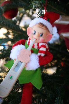 nurse christmas tree elf with a thermometer