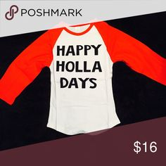 """Happy Holla Days Kids Graphic Raglan Tee Get your little ones ready for the """"Holla days,"""" in this cute graphic raglan tee! Brand New in perfect condition without flaws.   All items come from a smoke free home and are shipped on the same or following day an order is placed.   Reasonable offers are considered and often accepted. Deals on bundles are also available. Shirts & Tops Tees - Long Sleeve"""