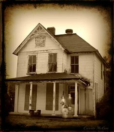 This is such and awesome creepy picture! Look closely for the 'ghost' family! I framed it for my Halloween decor!
