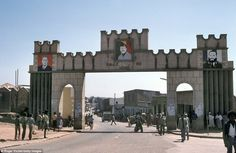 The gate at the entrance of the modern city of Harar with the portraits of Brejnev and of ...