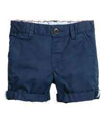 Dark blue. Shorts in soft washed cotton twill with an adjustable elasticated waist, zip fly and button. Side pockets and a fake welt pocket at the back.
