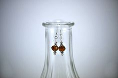 Brown Faceted Crystal with Silver Accents Drop Earrings by KoningStilsonDesign on Etsy Faceted Crystal, Crystal Earrings, Drop Earrings, Glass Vase, Etsy Shop, Crystals, Trending Outfits, Brown, Unique Jewelry