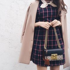 Haruna Kojima looking prim and ready for the colder days in the Libertine Dress #SJsisterhood