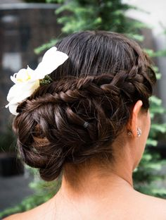 A cleaned-up version of the Katniss braid is a lovely wedding day hairstyle. #weddinghairstyles #wedding #hair