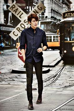 Kim woo bin in classic button up (or down pending your country reference) and jeans.  As an aside the backdrop of this photo could make great couple pics.  Fashion app #fadstir #mensfashion #dresscasual