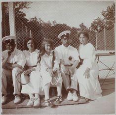 Nicholas with Tatiana, Anastasia, Olga, and an officer at the Livadia tennis court, 1914