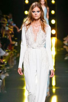 Long-sleeve jumpsuit by Elie Saab featuring a v-neckline lace bodice with embroidery that flows down the pants.