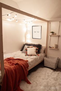 A canopy bed with string lights, hanging shelves, a faux fur rug, and pillows with tassels complete this fun teen girl's boho room! bedroom decor A Boho Room For My Niece - Stacy Risenmay Cute Room Ideas, Cute Room Decor, Diy Room Ideas, Sunroom Ideas, Small Room Decor, Wall Decor, Living Room Arrangements, Bedroom Arrangement, Boho Room