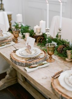 Photo: Jacque Lynn Photograhy Stlying: Michelle Leo Events decorating table in winter with round slices of wood as plater charger. pine and cones in the middle