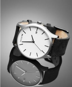 MVMT -watch White/Black Leather. I would probably buy this immediately if it just had numbers 6, 9 and 12.