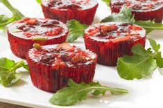 Cranberry-Pineapple Minis - 1 can  (20 oz.) DOLE Crushed Pineapple, in juice, undrained, 2 pkg.  (3 oz. each) JELL-O Raspberry Flavor Gelatin, 1 can  (16 oz.) whole berry cranberry sauce, 2/3 cup  chopped PLANTERS Walnuts, 1  DOLE Apple, chopped.
