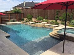 Dallas Formal Pools, Rockwall Custom Pool - formal-pool-spa-leuders-coping-travertine-pavers-pebble-plaster-aqua-blue-sheer-descents-raised-wall-with-mixed-veneer-