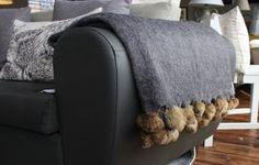Dark grey pom pom blanket www.waringsathome.co.uk