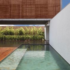 THE BT HOUSE BY STUDIO GUILHERME TORRES IN BRAZIL. Gorgeous rich colour from decking that blends perfectly with wooden mashrabiya.