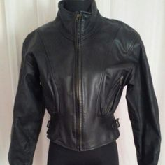 Leather Dolman Sleeve Moto Black Jacket Size-S  Color- black This black leather distressed motorcycle jacket is a must have for an edgy wardrobe.  - 100% distressed leather - Back pleated design - 2 inside pockets - 2 front zip up pockets - Front zip - Buckles on each side by the waist for a cinched and fitted waist - Snap close at the wrists - Fully lined - Dolman sleeves Length- 19.5 inches Chest- 19 inches Sleeves- 21.5 inches *Small spots of rubbing off of the leather on 1 shoulder. See…