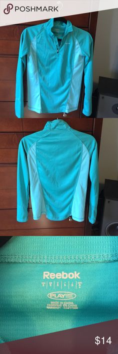 Reebok Play Dry lightweight 1/4 zip baselayer Lightweight Reebok Baselayer Pretty two toned turquoise color. Silkily soft polyester but thick enough to hide your flaws. 1/4 zip. Worn Once. Love it but too small for me. Reebok Tops Tees - Long Sleeve