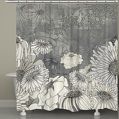 A unique way to enhance any bathroom, the Laural Home® Flowers On Grey Shower Curtain uses a mixed media technique to create contoured flowers that stand out on a grey background. This inviting shower curtain is machine washable and easy to care for.