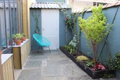 Justine's outdoor space has been brought to life with Inchyra Blue walls and a Lamp Room Gray door.