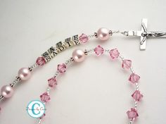 Personalized Name Rosary Pink Baptism by DesignsbyCrissi on Etsy (Home & Living, Spirituality & Religion, Prayer Beads & Charms, Rosaries, rosary, first communion, communion rosary, communion gift, boy rosary, girl rosary, baptism rosary, christening rosary, christening gift, baptism gift, godparent godchild, name rosary, personalized rosary)