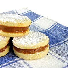 Alfajores are shortbread sandwich cookies that are held together with a spoonful of dulce de leche Peruvian Desserts, Peruvian Dishes, Peruvian Cuisine, Peruvian Recipes, Cookie Desserts, Cookie Recipes, Dessert Recipes, Holiday Desserts, Delicious Desserts