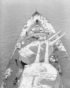 HMS Royal Oak in the North Sea showing snow covered deck.