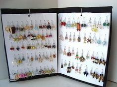 Recycled earring rack/organizer.  I made these in 3 tiers tall for my craft shows.... I could arrange all my earrings on 3 of these, (1000 pair of earrings!!) at home... and then open them up and place on the table.  It made set up sooo easy, and my customers loved having such an assortment to choose from.  When someone made a purchase, I wrappe...