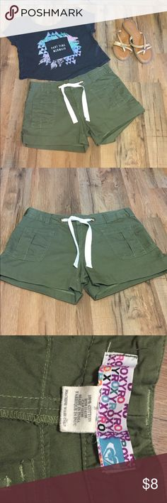 Roxy Olive Green Shorts These awesome Like New Roxy shorts will add versatility to your summer closet! Zipper and hook closure with accent rivets and white drawstring for the perfect fit. 100% cotton. Size 5 Roxy Shorts
