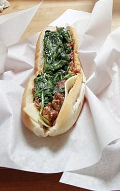 Pork Italiano.  Slow roasted pork. Provolone cheese and broccoli raab, or spinach, and of course garlic! Delicious!!