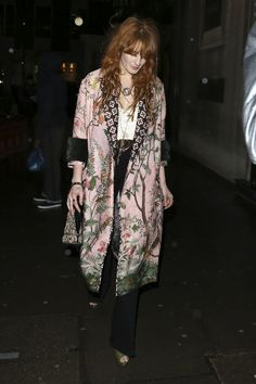 Spotted in London, Florence Welch in a Gucci Spring Summer 2016 pink oriental screen printed coat by Alessandro Michele.