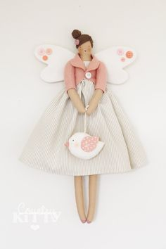 Fairy angel doll in white and peach pink shades with bird