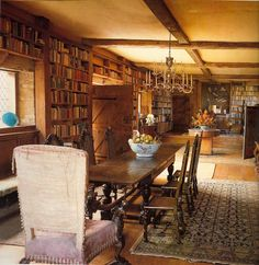 The Long Library showing the silver chandelier which is a copy of the one at Knole and the dining table, at Sissinghurst, home of Vita Sackville-West and her husband Sir Harold Nicolson, near Cranbrook, Kent. This room is the largest in the existing house and was created out of the old stables, and contains the 4,000 books accumulated from 40 years of reviewing. Perfection!