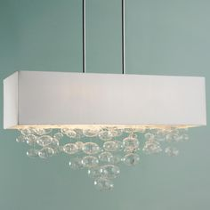 Rectangle Shade and Glass Bubbles Island Chandelier From a white kitchen island to a glass dining table, this handblown clear glass ornament rectangular chandelier floats with modern elegance. Chrome hardware with white fabric shade