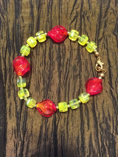 Yellow and red glass bead bracelet. The Sparkling Flamingo on Artfire Beaded Necklace, Beaded Bracelets, Red Glass, Handcrafted Jewelry, Flamingo, Glass Beads, Sparkle, Yellow, Handmade Chain Jewelry