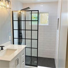 Check out our popular grid pattern French Linea Toulon shower door in this clean and modern bathroom, expertly installed by @ability_glass in Houston, Texas! The single panel construction creates a really spacious walk-in shower design, which is reversible for a right- or left-side opening to fit your layout perfectly. All the focus goes to that iconic, French door inspired pattern, which is made from our ultra-durable JetGlaze paint for easy maintenance. Walk In Shower Designs, Frameless Shower Doors, Harry Styles Wallpaper, Upcycled Home Decor, Diy Interior, Home Renovation, Modern Bathroom, French Doors, Dreamline Shower