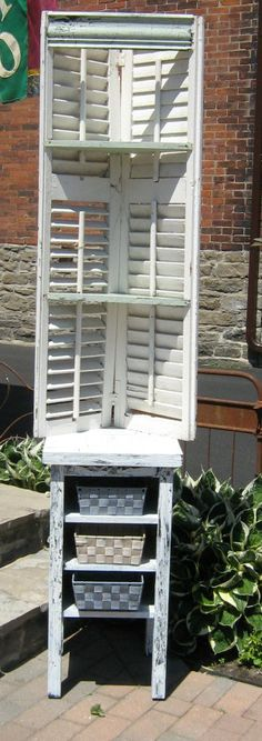 love this for a corner shelf!     Shabby chic table with vintage shutters