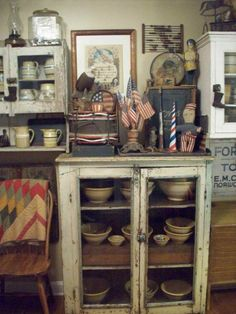 it's a little busy for me but love yelloware and love americana so wanted to pin this for decorating inspiration Primitive Cabinets, Primitive Kitchen, Country Kitchen, Prim Decor, Country Decor, Pie Safe, Primitive Gatherings, Home Of The Brave, Cubbies