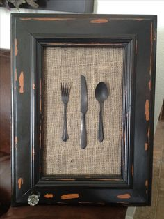Old cabinet door black painted and distressed.  Burlap glued on pressed wood as a background.  Black painted flatware and glued  on back ground.  Screwed an antique door nob.  I love this project!!!