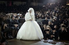(R) Oded Balilty / AP  The bride Nechama Paarel Horowitz fulfils the Mitzvah tantz, in which family members and honored rabbis are invited to dance in front of the bride, who holds one end of a gartel. At the end the bride and groom dance together.