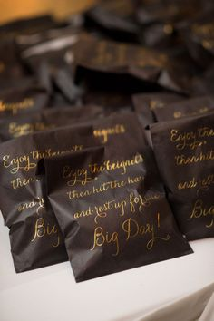 ann whittington events elegant rehearsal dinner southern style country club beignet dessert favor black bag with gold calligraphy Gold Calligraphy, Rehearsal Dinners, Southern Style, Real Weddings, Houston, Wedding Planning, Events, Dessert, Club