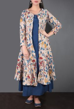 A flowy Kalamkari cape in beige flaunting eye-catching Kalamkari pattern. The cape features nature-inspired patterns of colorful birds, creepers, flowers in tones of blue, red and yellow. The cape is tailored in a flared fit and has side pockets. Kurti Designs Party Wear, Salwar Designs, Blouse Designs, Kalamkari Dresses, Casual Dresses, Fashion Dresses, Women's Fashion, Indian Designer Suits, Indian Dresses