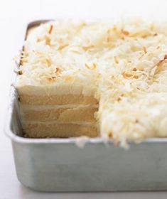 Toasted-Coconut Refrigerator Cake    Ingredients  1/4  cup  flaked sweetened coconut  1  cup  heavy (or whipping) cream, whipped to a soft peak  2  pound cakes (such as Sara Lee), about 11 ounces each  2  cups  Vanilla Pudding  Directions  Preheat oven to 350° F. Spread the coconut on a baking sheet and toast in oven until golden, about 10