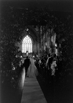 Jacqueline Bouvier escorted by her step-father, Hugh D. Auchincloss, walks down the aisle at St. Mary's Catholic Church in Newport, Rhode Island for her wedding to Senator John F. Kennedy on September 12, 1953.