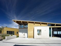 Stucco & wood, & cool modern lines...