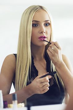 """""""I contour my cheeks using a matte and apply blush to the apples of my cheeks, which gives me a healthy, flushed look, like I just went for a jog. After blush comes highlighter to further enhance my cheekbones. I then fill in my brows, apply my eyeshadow (I prefer copper tones to make my eyes appear more blue) and apply mascara. I like long, spidery lashes because it makes your eyes appear much bigger! Lipstick is last in a nude salmon pink, it looks great against tanned skin"""" - Lauren…"""