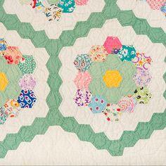 Vintage scrappy GFG close-up. Grandmothers Flower Garden quilt Hexagons