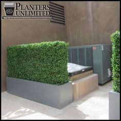 Artificial Boxwood Hedges in Planters blocking unsightly views on a rooftop garden.