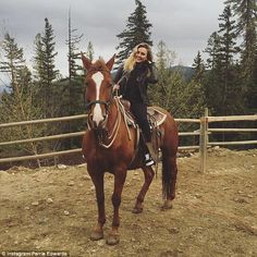 Giddy-up: The pop princess shared a snap of her riding a horse, as she beamed from ear to ...